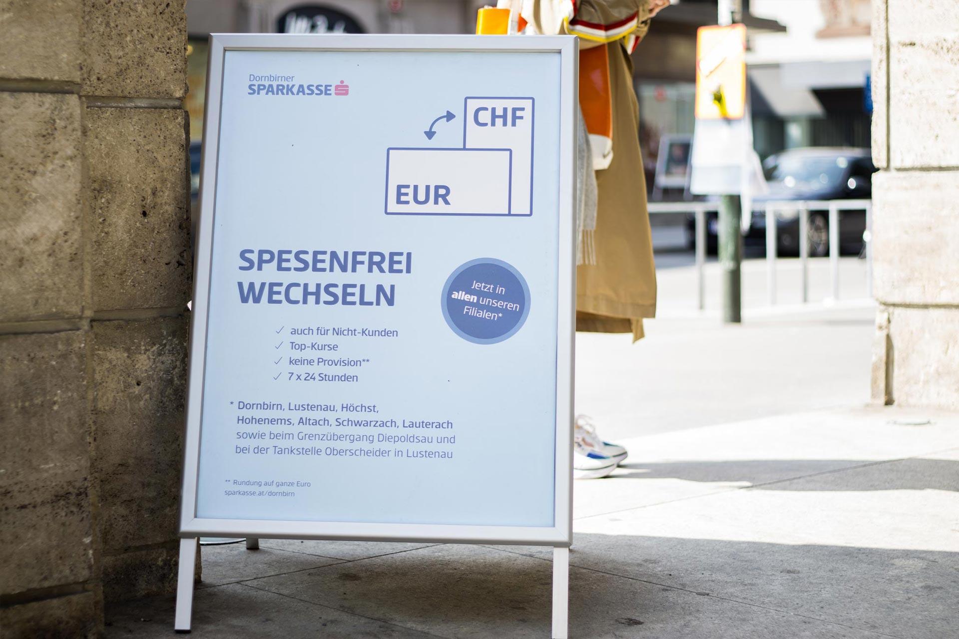 Plakat für die Wechselautomaten der Dornbirner Sparkasse – von Bernhard Hafele